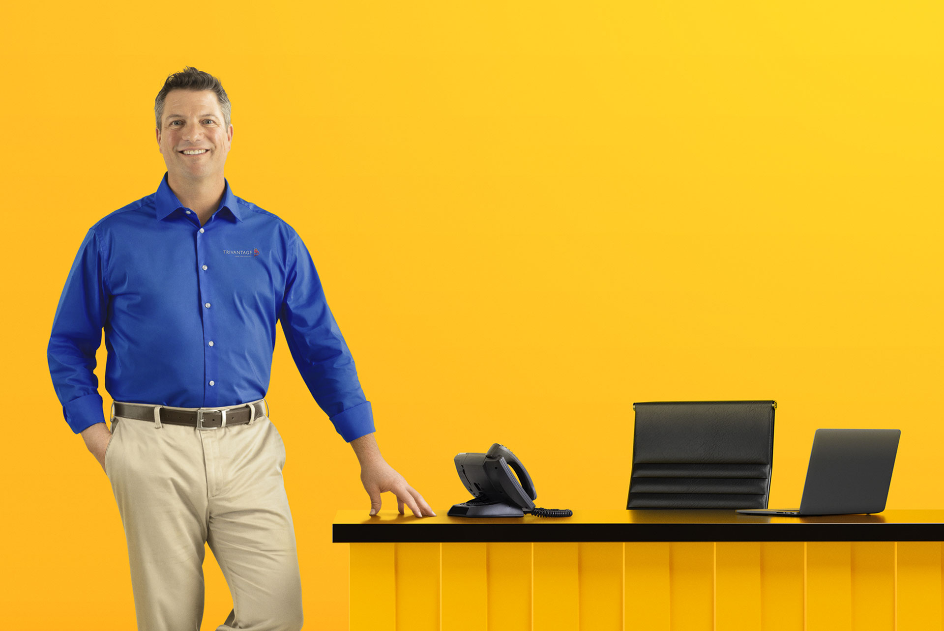 salesperson next to desk
