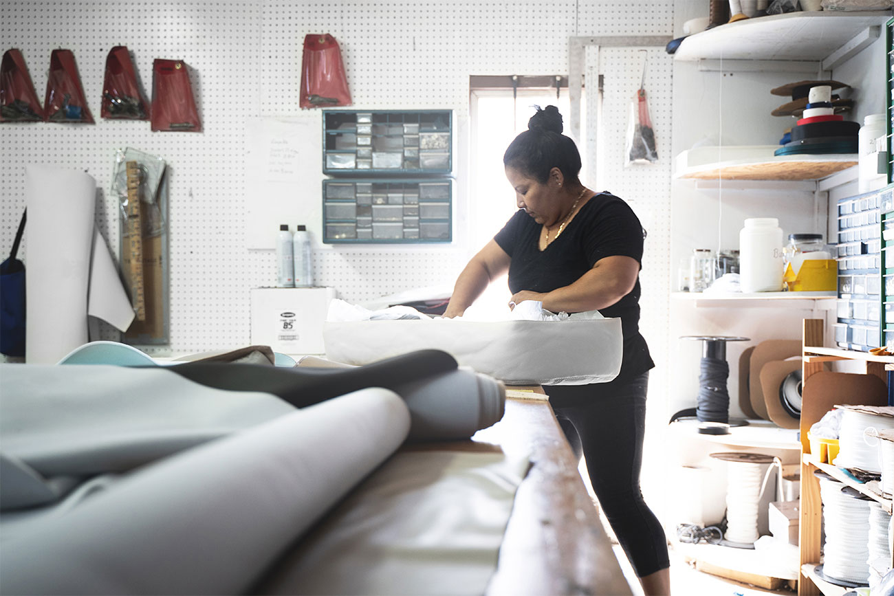 woman building boat cushion in workshop