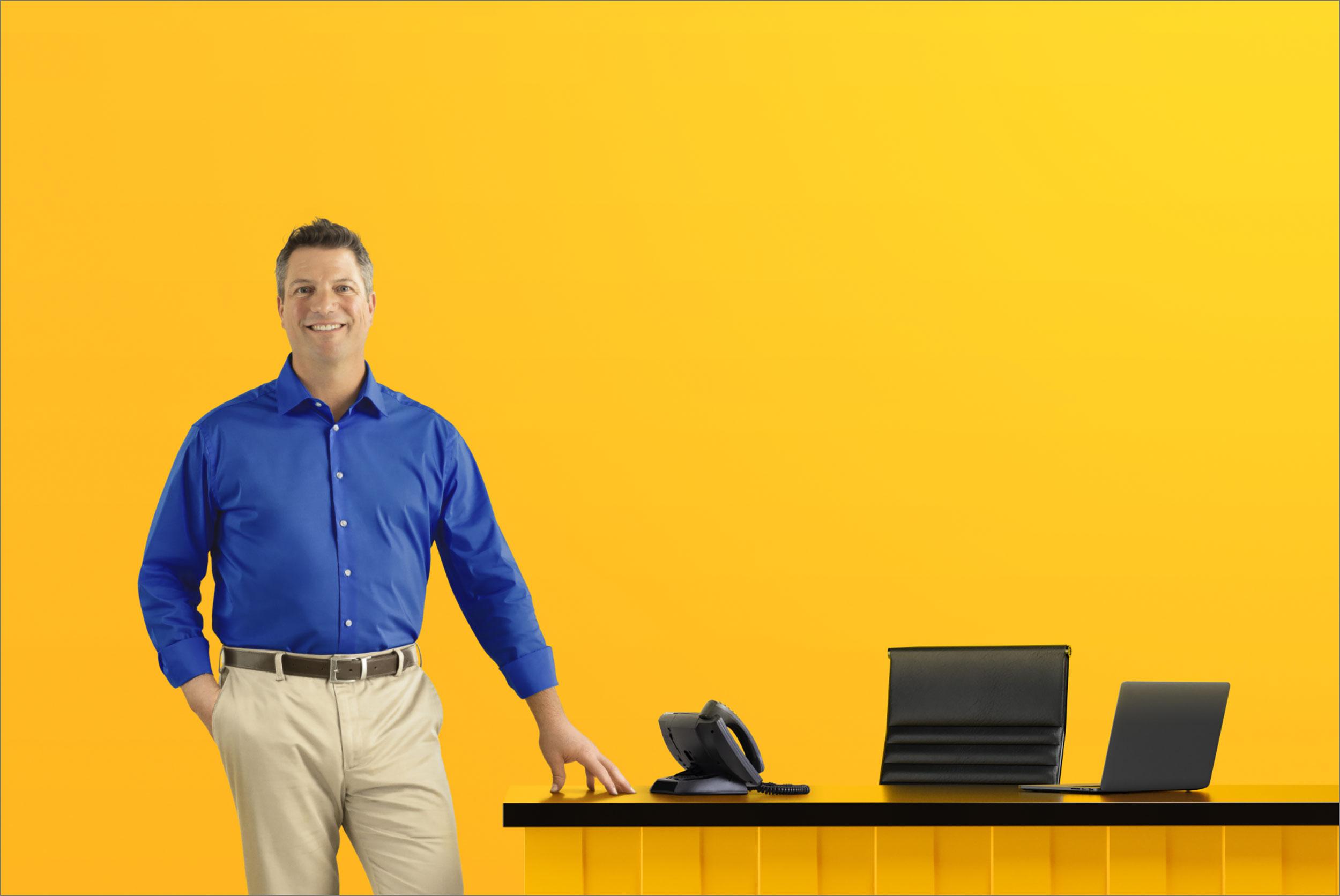 salesperson next to desk