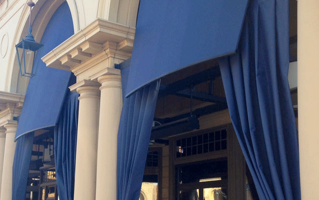 patio with awning and curtains